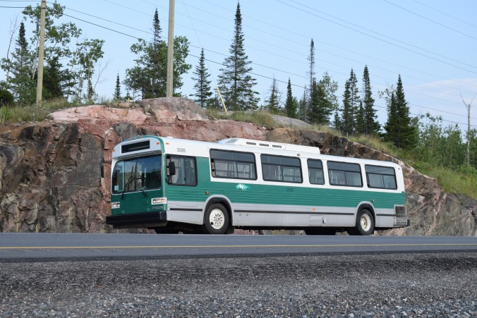 The 1990 Classic Transit bus pictured on the side of the highway