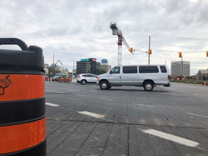 A van drives over the construction site.