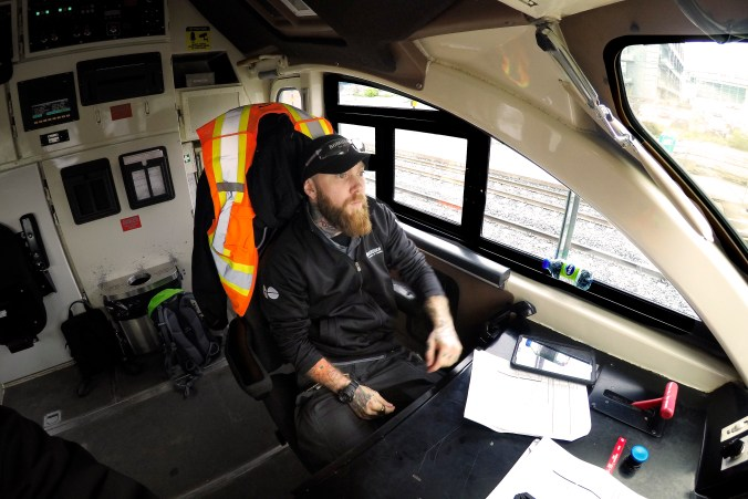 Tyler Austin is shown in a seat at the front of a GO train.