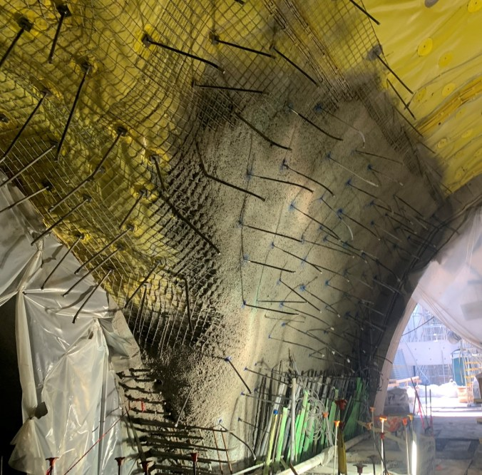 Image shows a tunnel with yellow spray on it.