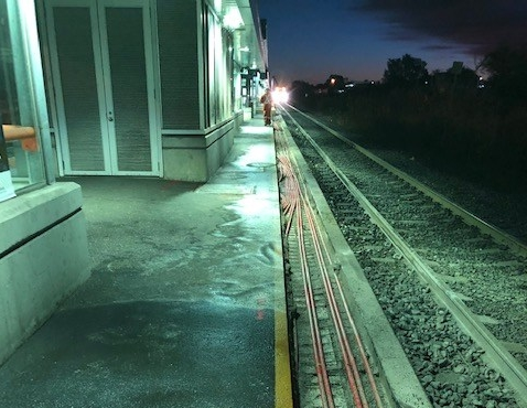Image shows a train platform with a section, over the yellow line, taken out as reapairs continue.