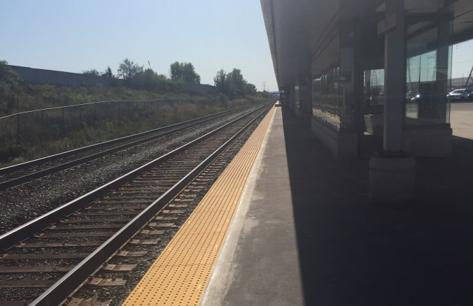 Tactile, yellow strips are shown on an empty platform.