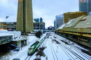 A train moves through the Union Station corridor on a snowy day.