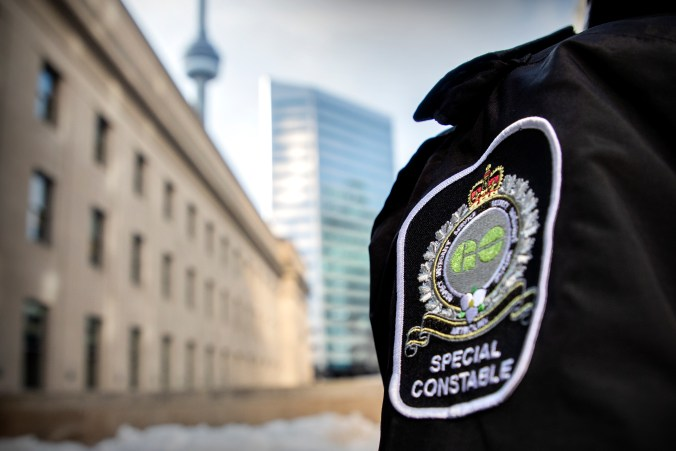 Image shows the uniform patch of a Special Constable, outside Union Station.
