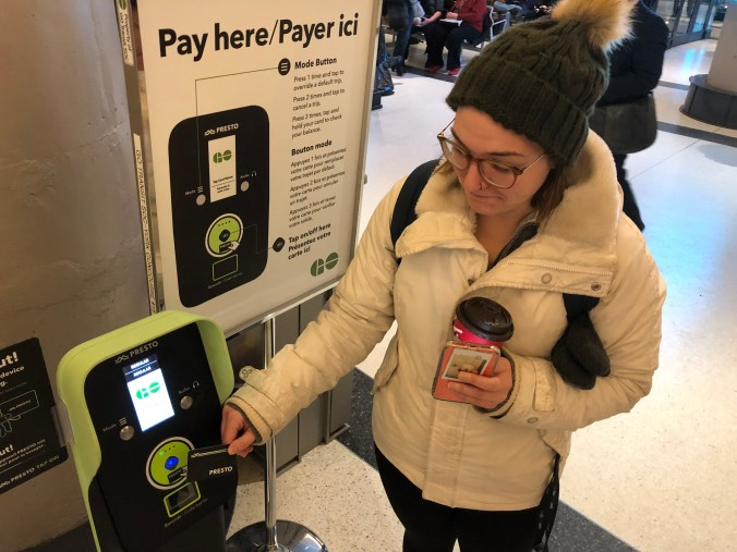 Image shows Erica tapping her PRESTO card.
