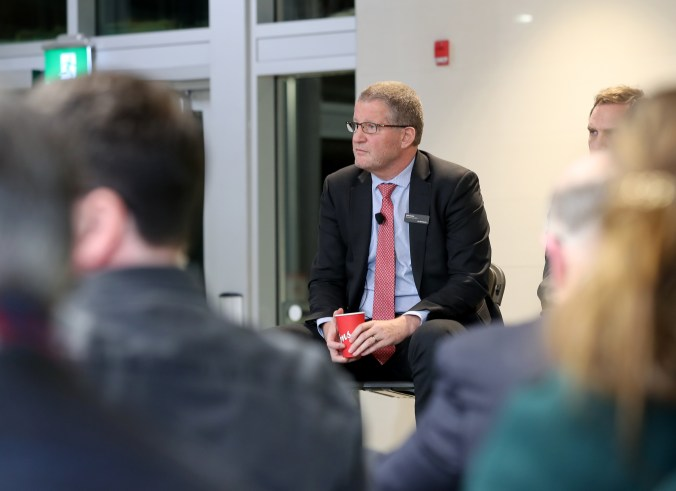 Image shows Phil Verster listening carefully.