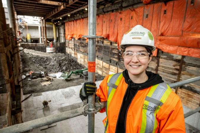 Image shows Sarah at the construction site.