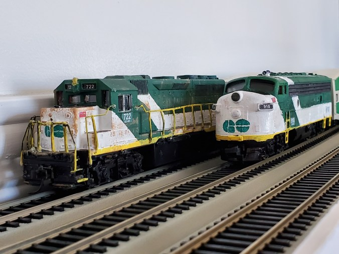 Image shows two tiny GO trains.