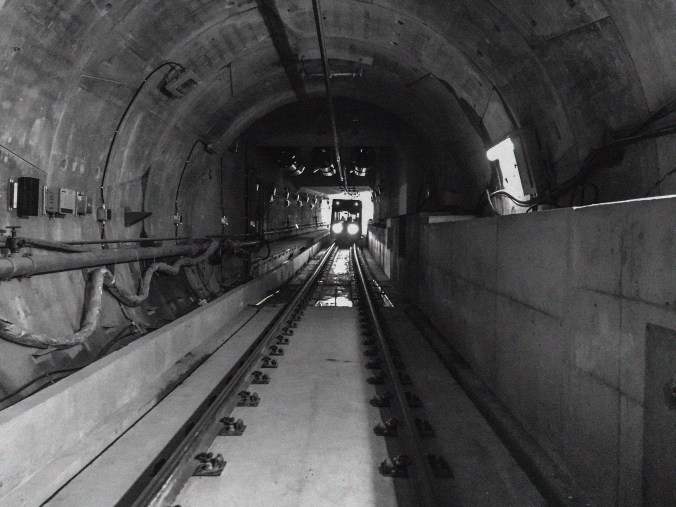 Image shows a LRV at the far end of a tunnel.