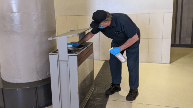 Station staff cleaning surfaces at Union Station