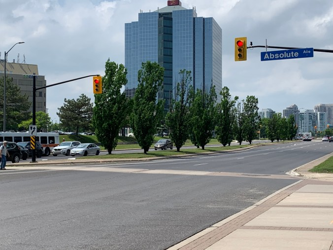 Image shows an intersection with red lights.