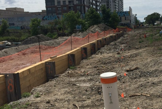 Images shows shoring wall construction,