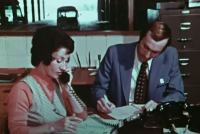 A look inside the central dispatch office where operators would take down customer information using a pen and binders. (Still image from the Ontario Archives short documentary People on the GO)