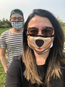 Two people wear face masks