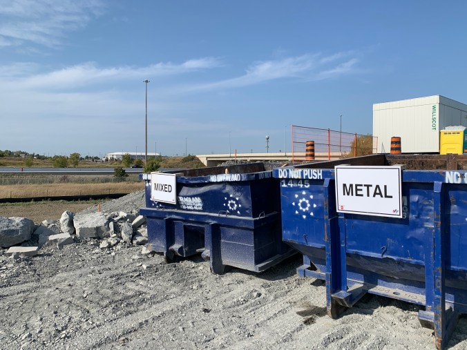 Two bins sits next to one another - one for mixed debris and one for metal.