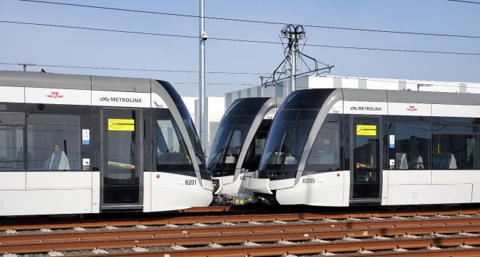 Two light rail vehicles are connected together.
