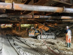 Image shows a low roof over tunneling work.