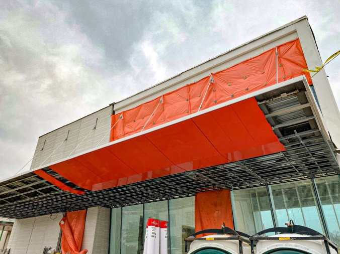 Image shows orange material over an entrance to the station.