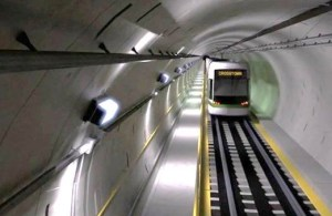 An artist rendering of a train in a tunnel.