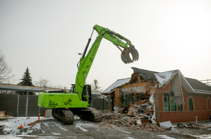 a large bulldozer in the process of demolishing the Agincourt GO station building