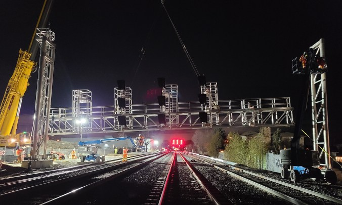 A new signal bridge is installed over the tracks