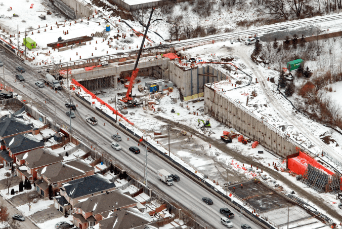 Image shows traffic flowing near a construction site.