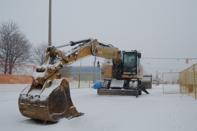 Image shows a tractor in the snow.