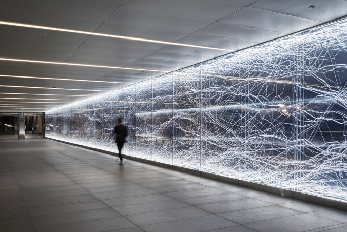 Image shows the artwork as a pedestrian walks by