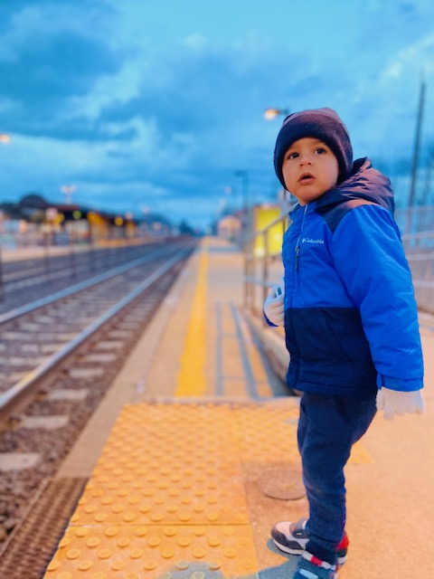 Little boy waiting for train