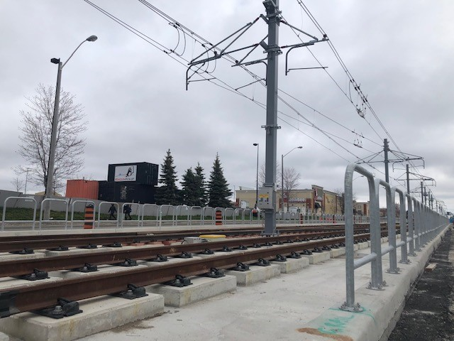 The tracks and overhead catenary system along Eglinton Crosstown LRT route