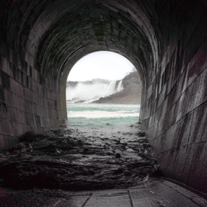Image shows a tunnel leading into the falls.