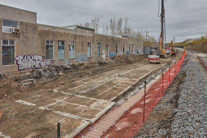 Image shows heavy equipment leveling off ground.