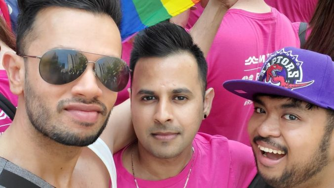 Kam Somji poses for a photo with his friends at the 2019 Pride Parade