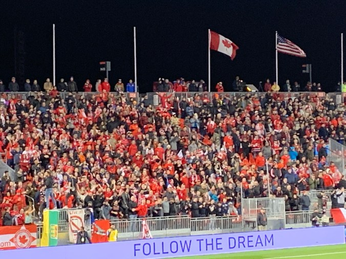 Image shows fans in the stands.