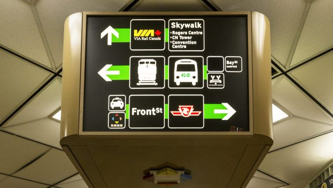 a close up of the directional signage in the old bay concourse
