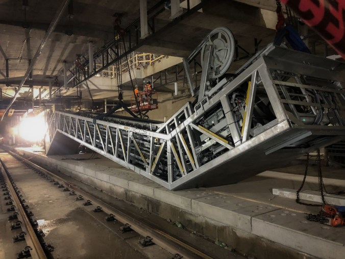 Image shows crews working on an escalator