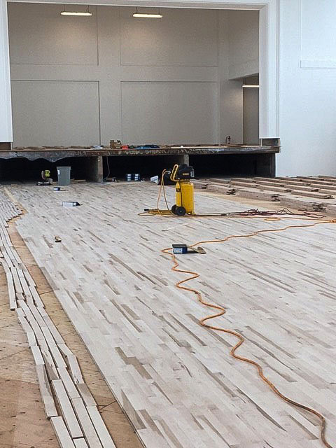 Hardwood floors are prepped inside the building.