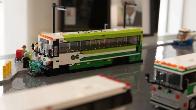 LEGO GO buses sit in model GO bus terminal