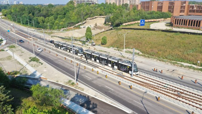 Two Crosstown vehicles head out on one of the first test runs along Eglinton Avenue East.