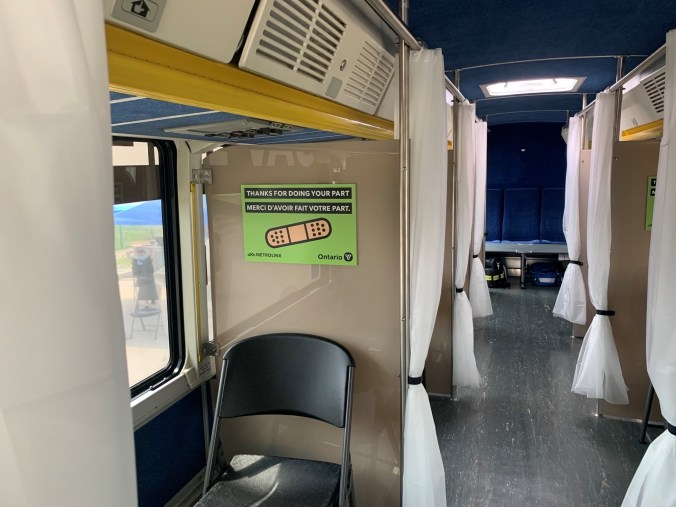 Image shows chairs inside a bus.