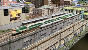 A model GO train sitting idle at a station