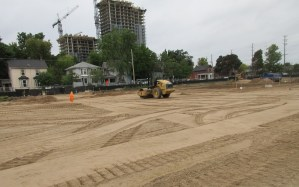 Image shows dirt being moved around.