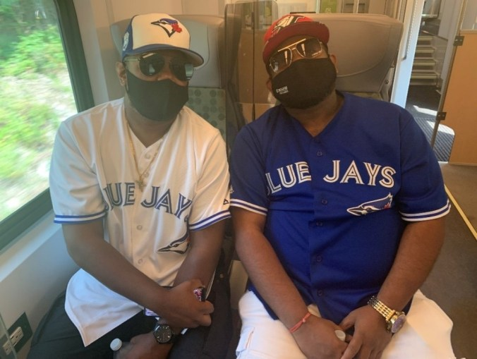 IMage shows the two men on a GO train.