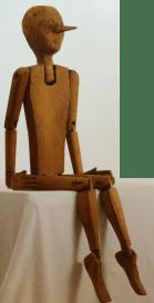 """Pinocchio, 1964, scultura in legno eseguita per lo spettacolo """"Pinocchio minore"""" di V. Franceschi."""
