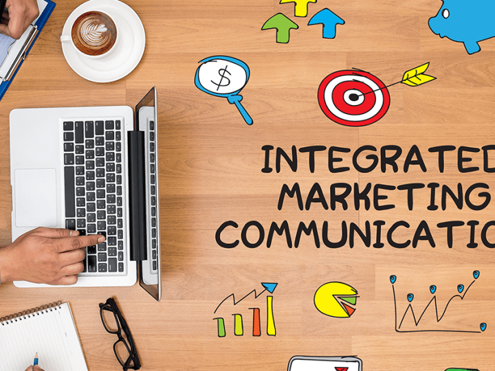 Integrated Marketing Communications graphic with people at table with a laptop