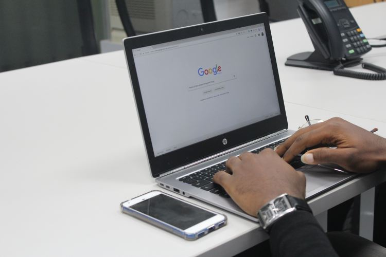 man at laptop on google.com