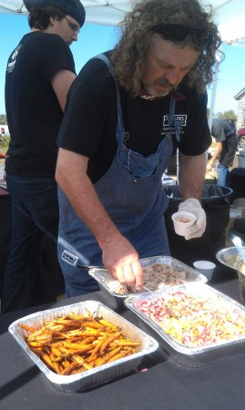 Jack Gilmore plating pork and grits