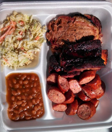 My three-plate order: brisket, beef rib, sausage, beans, wasabi cole slaw