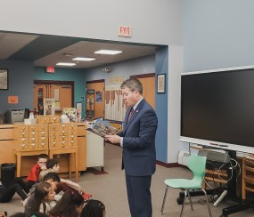 """Afterwards, he shared """"Two Bad Ants"""" by Chris Van Allsburg with two third grade classes. Students, teachers, and staff were thrilled to spend time with our special visitor."""