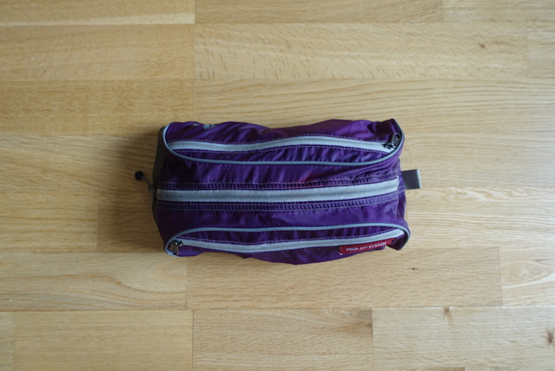 Bathroom bag packed with toiletries packed into Minaal Carry-on